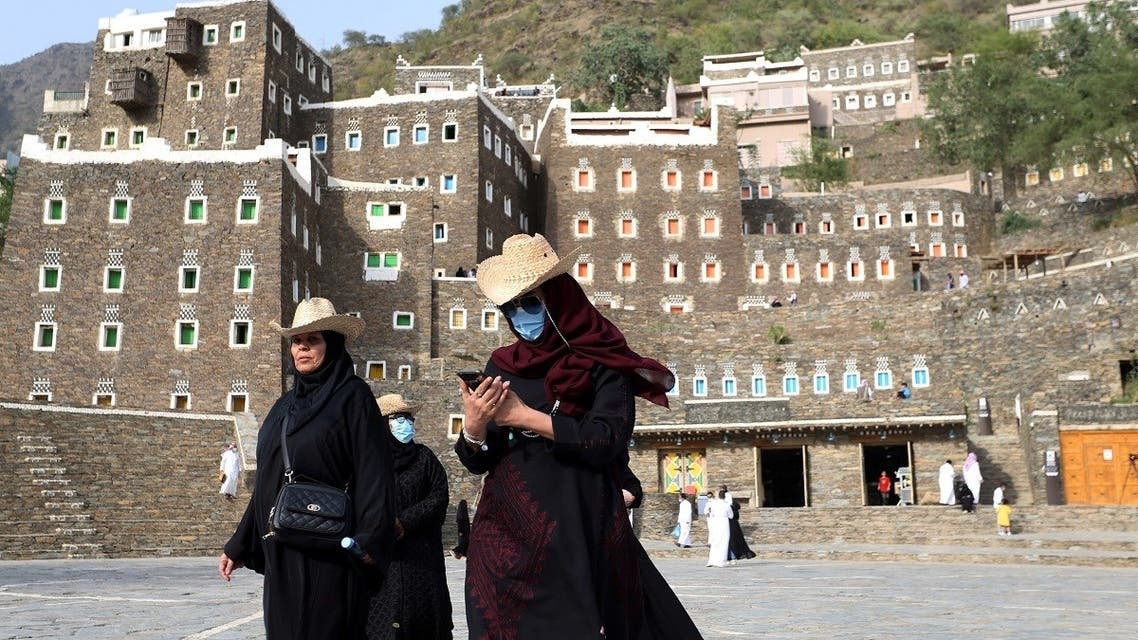 Tourists visit the cultural village of Rijal Almaa in the outskirts of Abha, Saudi Arabia July 17, 2020. (Reuters)