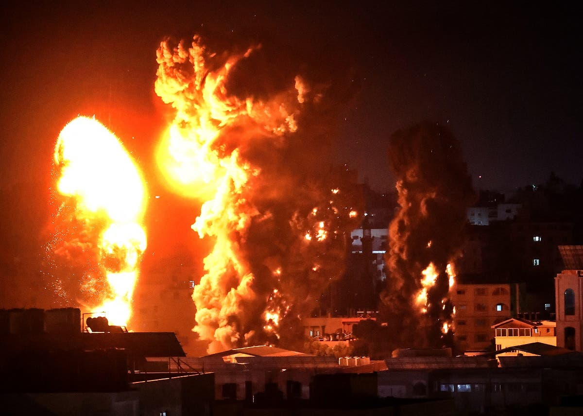 Fire and smoke rise above buildings in Gaza City as Israeli warplanes target the Palestinian enclave, early on May 17, 2021. (AFP)