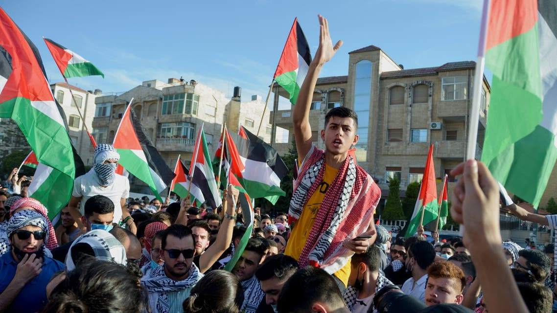 A demonstrator gestures during a protest to express solidarity with the Palestinian people, near the Israeli embassy in Amman, Jordan May 16, 2021. (Reuters)