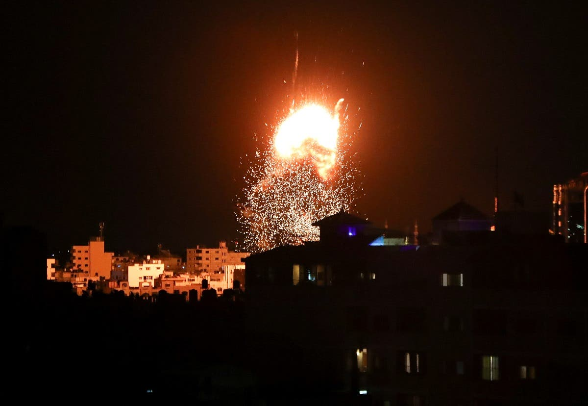 Smoke and flames rise above a building during Israeli air strikes, amid a flare-up of Israeli-Palestinian fighting, in Gaza City May 17, 2021. (Reuters)