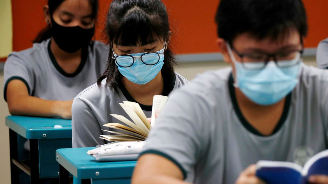 FILE PHOTO: Students wearing protective face masks read in class at Yio Chu Kang Secondary School, as schools reopen amid the coronavirus disease (COVID-19) outbreak in Singapore June 2, 2020. (File Photo: Reuters)
