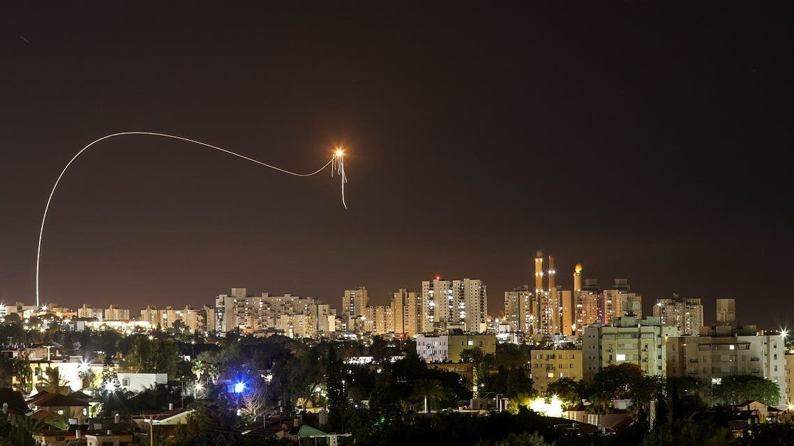 A streak of light is seen as Israel's Iron Dome anti-missile system intercepts rockets launched from the Gaza Strip towards Israel, as seen from Ashkelon, Israel. (Reuters)