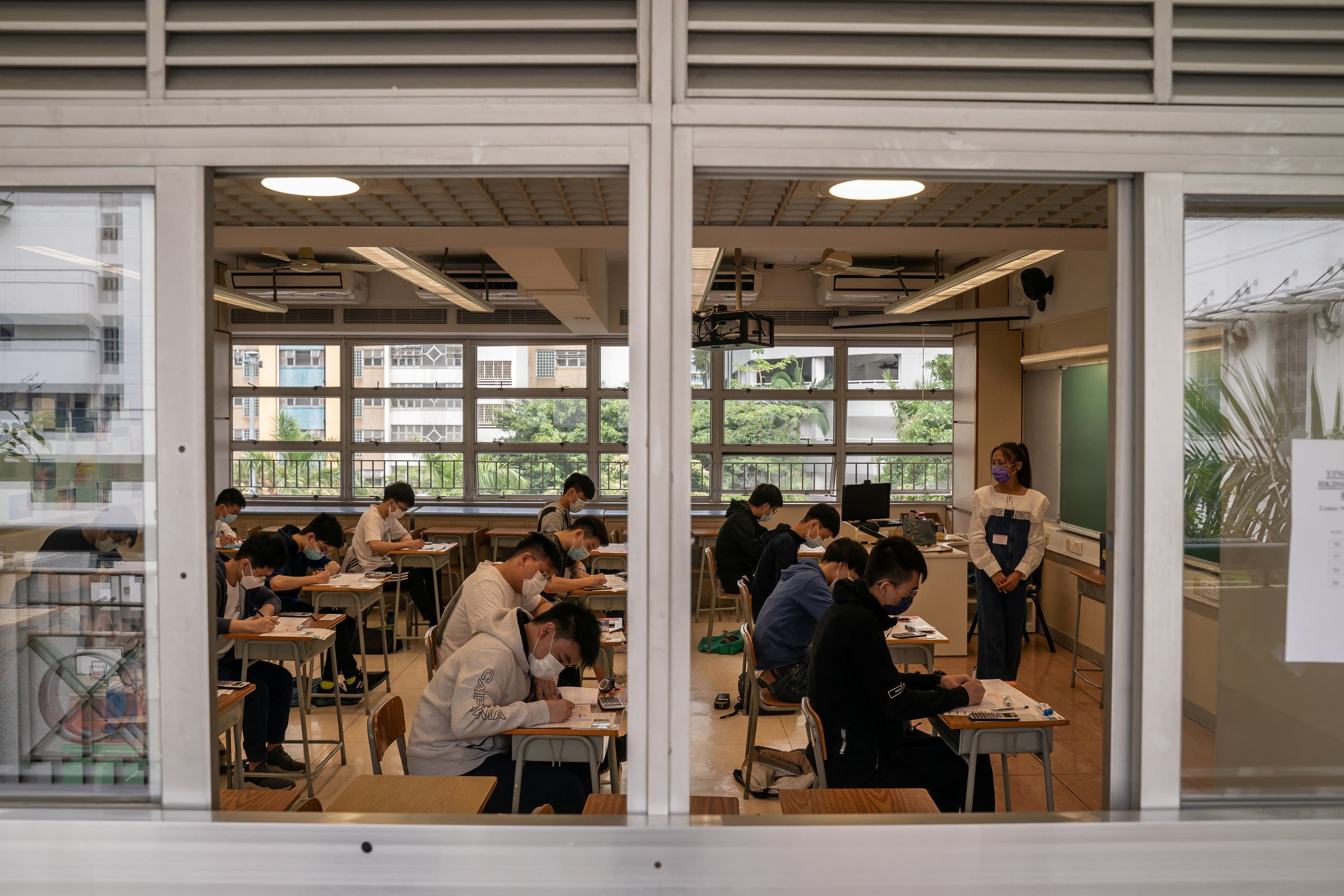 Students sit for the Diploma of Secondary Education (DSE) exams on April 26, 2021 in Hong Kong, China. (Reuters)