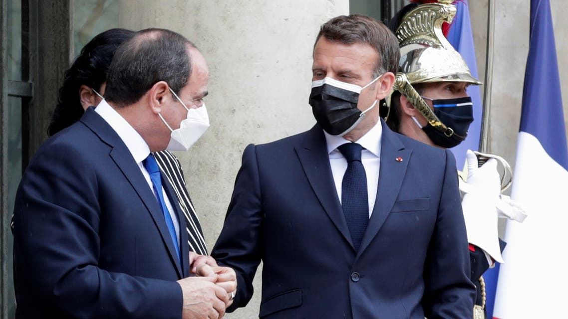 French President Emmanuel Macron listens to Egyptian President Abdel Fattah el-Sissi after their talks at the Elysee Palace in Paris, France May 17, 2021. Thibault Camus/Pool via REUTERS