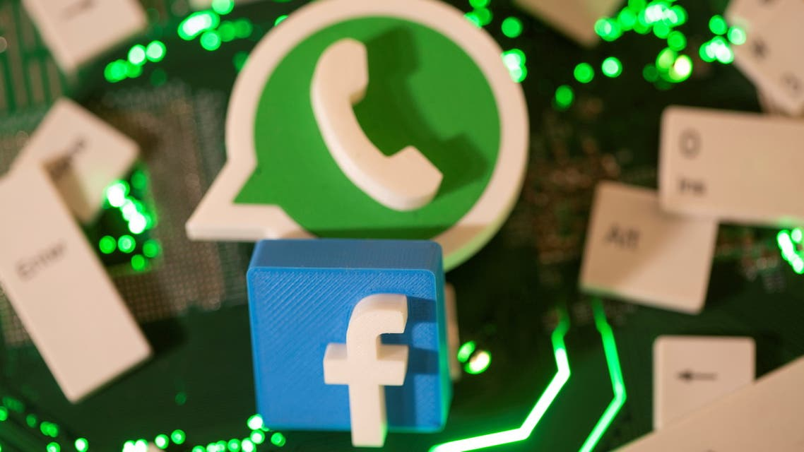 3D printed Facebook and WhatsApp logos and keyboard buttons are placed on a computer motherboard. (File Photo: Reuters)