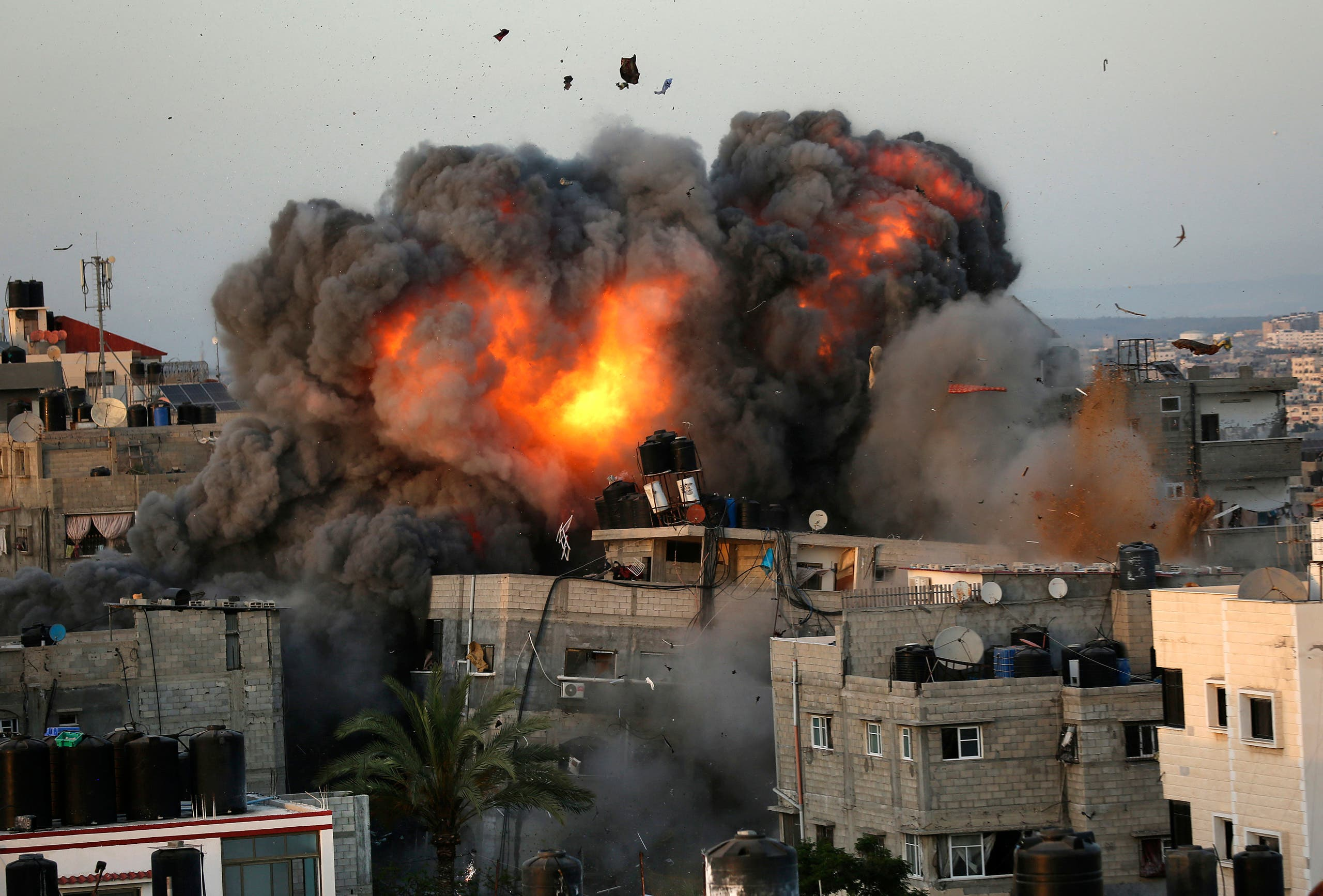 A ball of fire erupts from a building in Gaza City's Rimal residential district on May 16, 2021, during massive Israeli bombardment on the Hamas-controlled enclave. (AFP)
