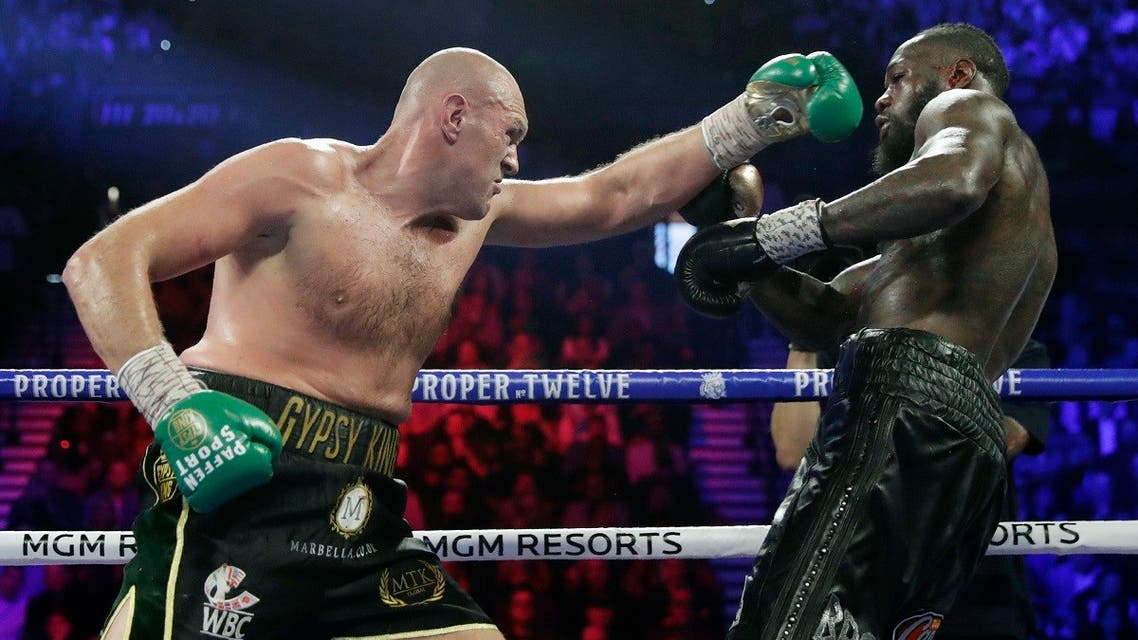 In this Feb. 22, 2020, file photo, Tyson Fury, left, of England, fights Deontay Wilder during a WBC heavyweight championship boxing match in Las Vegas. (AP/Isaac Brekken)
