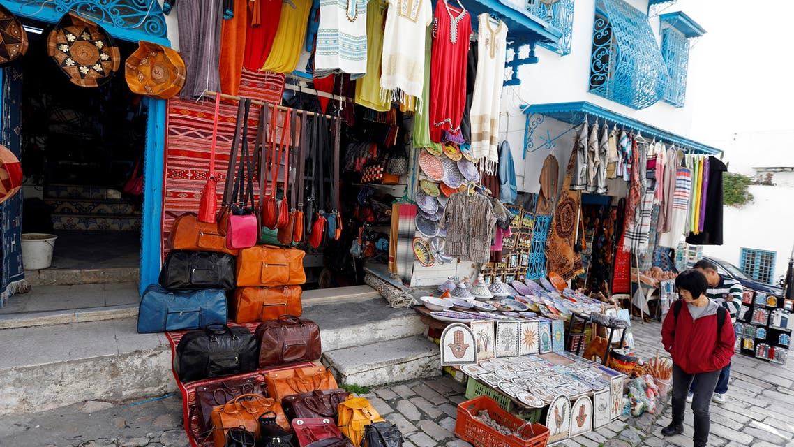 A tourist looks at traditional souvenirs displayed for sale in Sidi Bou Said, an attractive tourist destination near Tunis, Tunisia January 7, 2019. (File photo: Reuters)