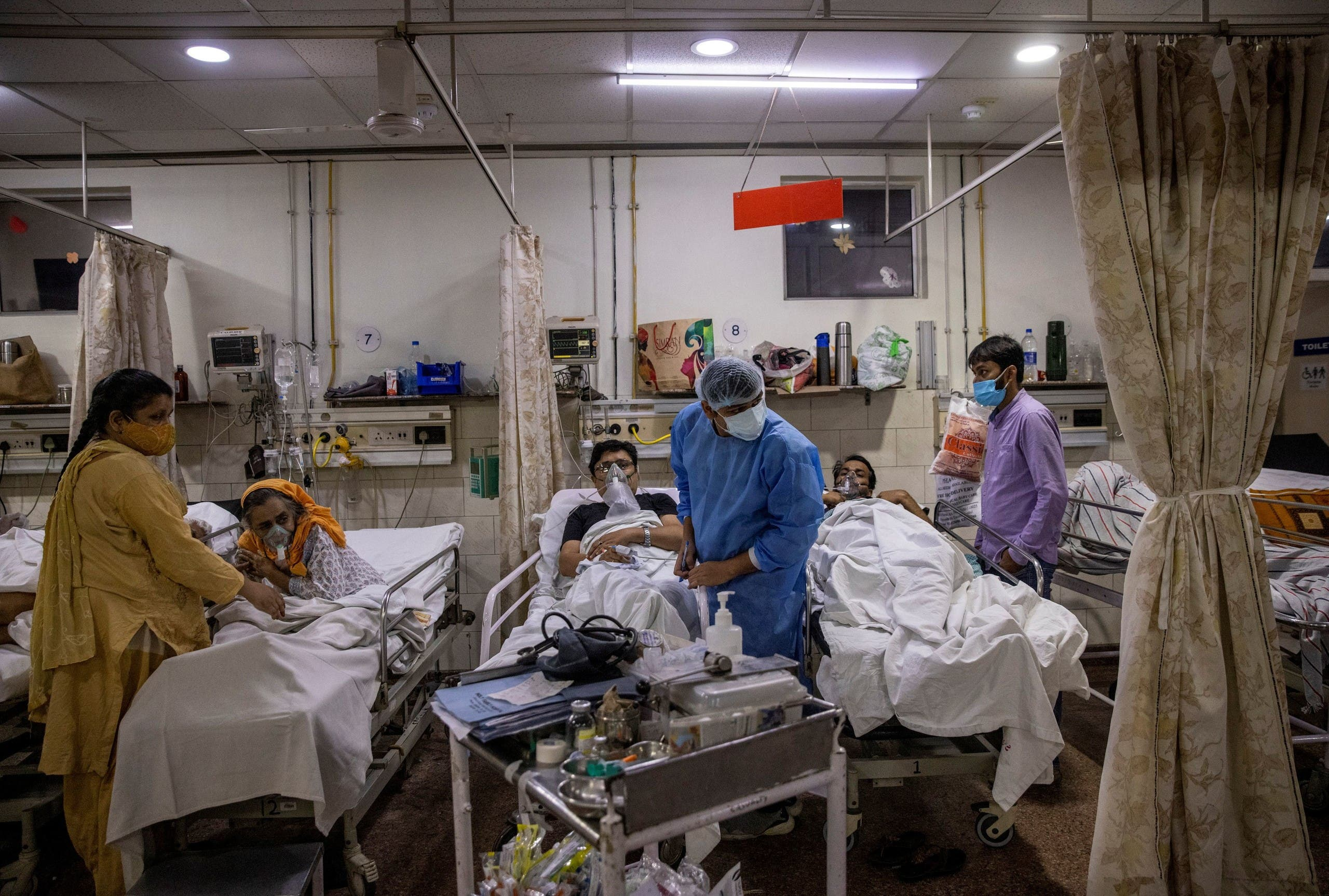 Rohan Aggarwal, 26, a resident doctor treating patients suffering from the coronavirus disease (COVID-19), tends to a patient during his 27-hour shift at Holy Family Hospital in New Delhi, India, May 1, 2021.