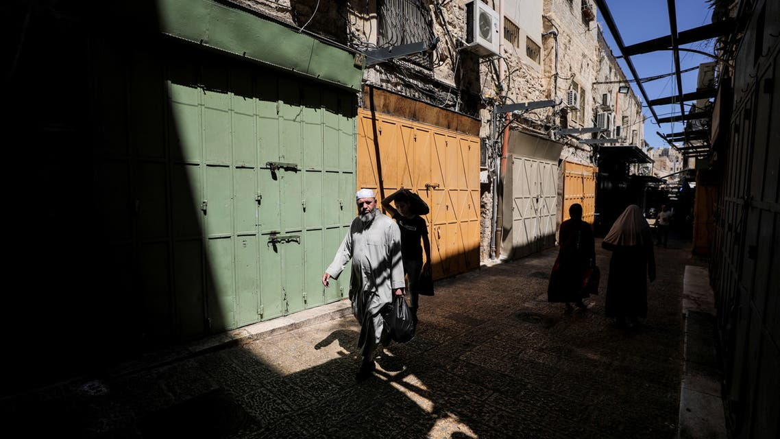 A Palestinian man walks past closed shops during a general strike called by Palestinians in the Israeli-occupied West Bank and Arab cities in Israel, over Israel-Gaza fighting, at a market in Jerusalem's Old City May 18, 2021. (Reuters)