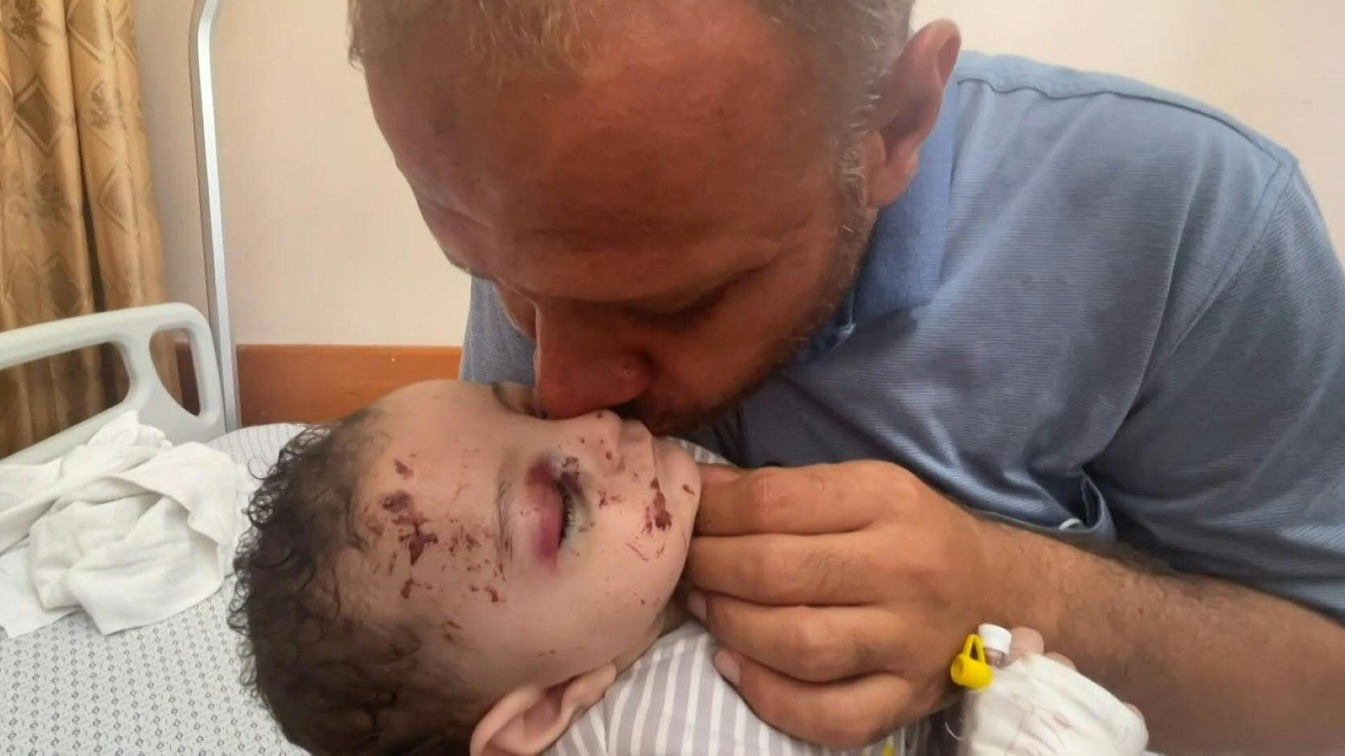 Inside a Gaza hospital, Mohammad al-Hadidi cradled his baby boy Omar -- his only surviving child after Israeli air strikes killed his wife and four other sons in the night. (File photo: AFP)