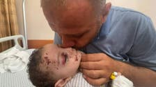 Gaza father who lost entire family in Israeli air strike holds his only surviving son