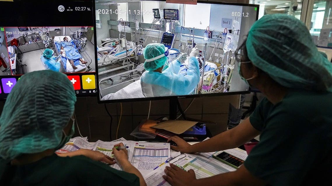 ICU nurses wearing face masks work and monitor the live footages of patients suffering from the coronavirus disease (COVID-19) in the Intensive Care Unit (ICU) at the King Chulalongkorn Memorial Hospital in Bangkok, Thailand, on May 11, 2021. (Reuters)