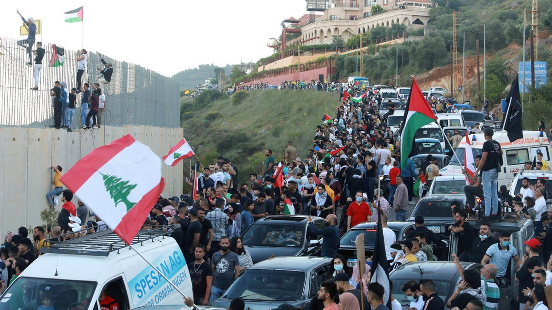 Demonstrators gather during a protest to express solidarity with the Palestinian people, in Adaisseh village near the Lebanese-Israeli border, southern Lebanon May 15, 2021. (Reuters)