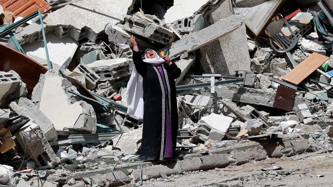 A woman reacts while standing near the rubble of a building that was destroyed by an Israeli airstrike on Saturday that housed The Associated Press, broadcaster Al-Jazeera and other media outlets, in Gaza City. (AP)