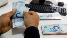 Tunisia's economy minister expects to conclude agreement with IMF within three months