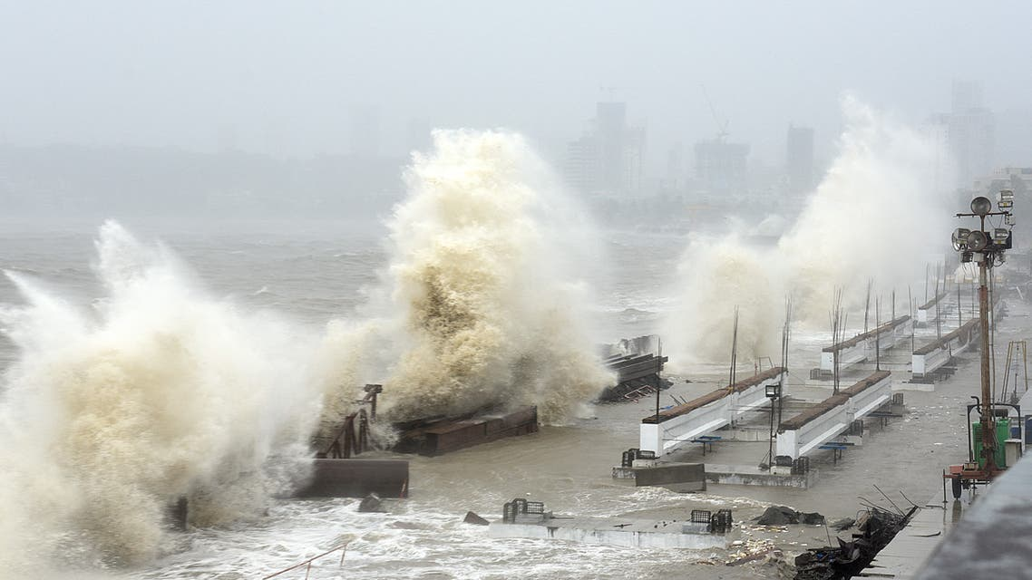 Waves lash over onto a shoreline in Mumbai on May 17, 2021, as Cyclone Tauktae, packing ferocious winds and threatening a destructive storm, surge bore down on India, disrupting the country's response to its devastating Covid-19 outbreak.