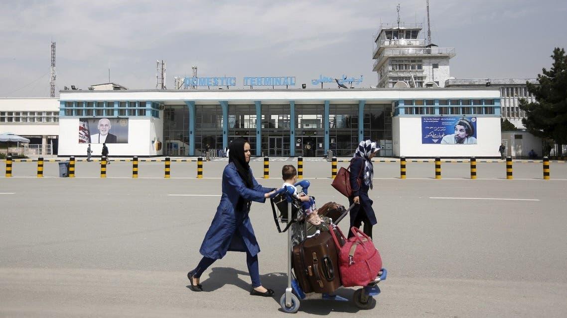 Afghan passengers walk in front of Hamid Karzai International Airport in Kabul, Afghanistan. (File photo: Reuters)