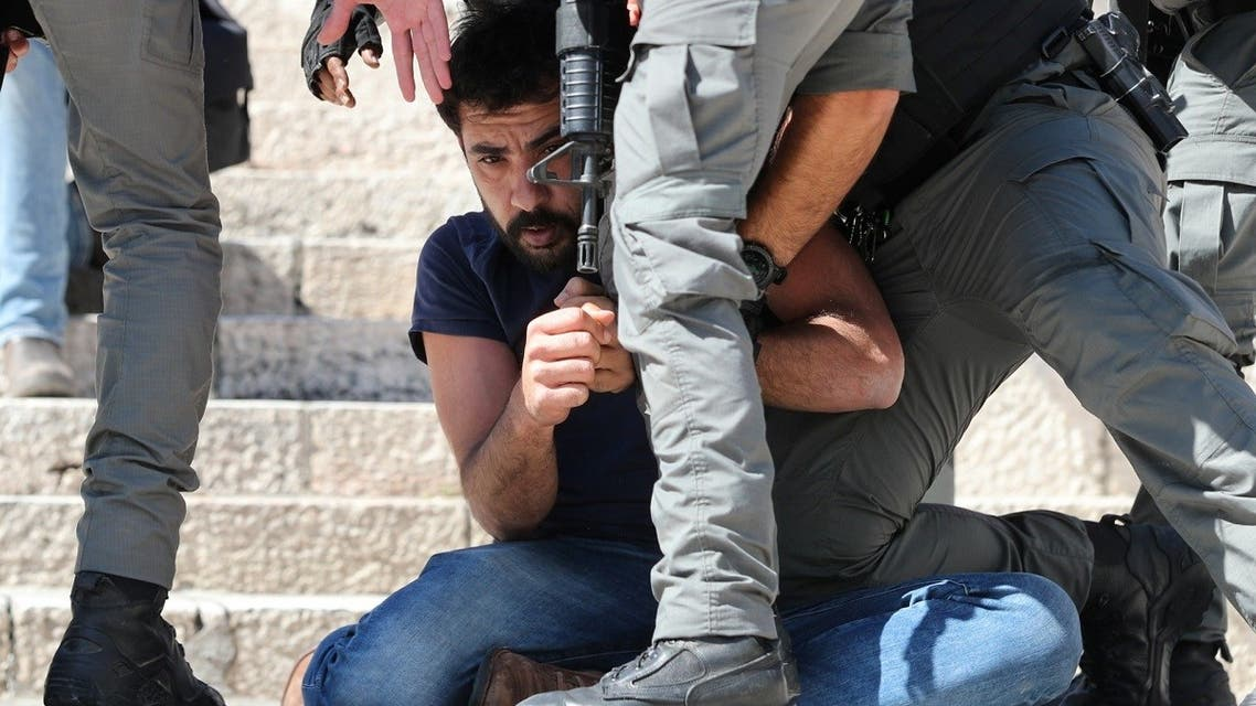Israeli security forces detain a protester during a demonstration held by Palestinians to show their solidarity amid Israel-Gaza fighting, in Jerusalem's Old City, May 18, 2021. (Reuters)