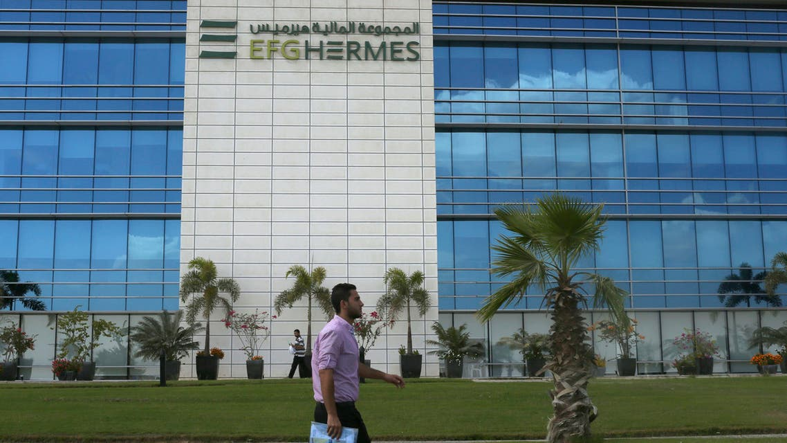 A man walks past the investment bank EFG Hermes at the Smart Village, on the outskirts of Cairo, October 20, 2014. (Reuters)