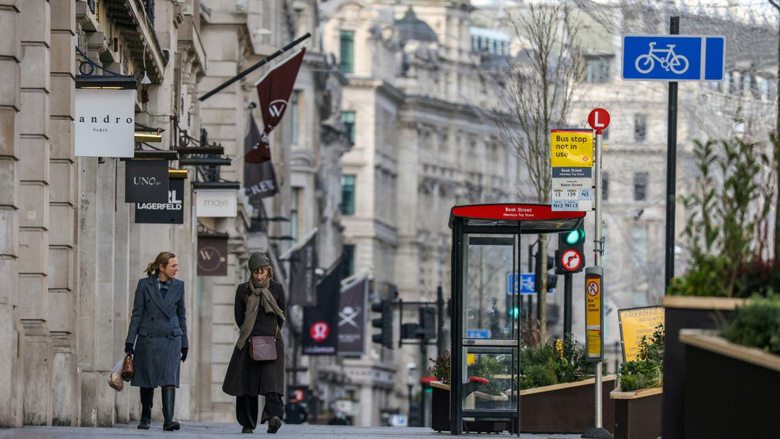 Two women walk down Regent Street, one of London's main shopping streets, January 17, 2021. (File Photo: Reuters)