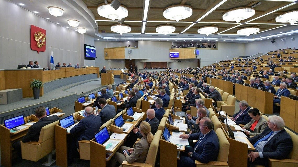 Russian parliamentarians listen to Prime Minister Mikhail Mishustin during a session of the State Duma, the lower house of parliament, in Moscow, Russia, on May 12, 2021. (Reuters)