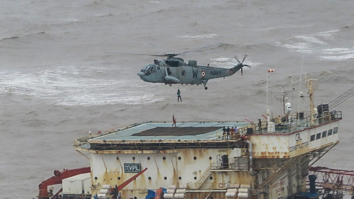 This handout photograph taken on May 18, 2021 and released by the Indian Navy shows stranded workers from a barge, which had gone adrift amidst heavy rain and strong winds due to Cyclone Tauktae, being airlifted by naval personnel on an Indian Navy Seaking helicopterduring an evacuation operation, in the Arabian sea. At least 27 people were dead and more than 90 missing on May 18 after a monster cyclone slammed India, compounding the country's woes as it recorded a new record number of coronavirus deaths in 24 hours. (File photo: AFP)