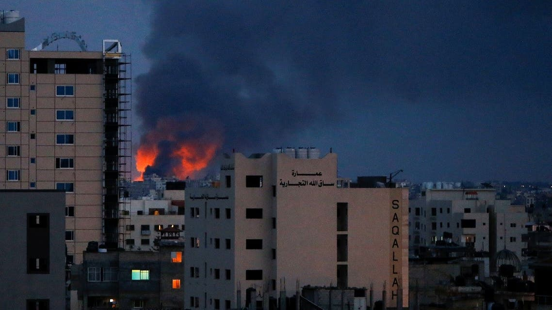 Smoke and flames are seen above buildings, amid a flare-up of Israeli-Palestinian fighting, in Gaza. (Reuters)