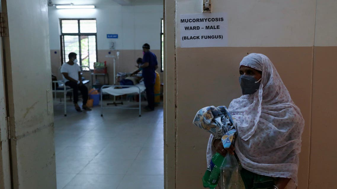A woman stands outside as a patient infected with black fungus is treated at the Mucormycosis ward of a government hospital in Hyderabad, India, Thursday, May 20, 2021. (AP Photo/Mahesh Kumar A.)