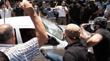 Lebanese attack Syrian voters supporting Assad in sign of growing resentment