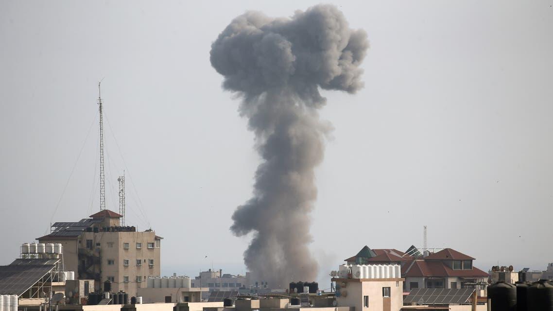 Smoke rises following an Israeli air strike, amid Israeli-Palestinian fighting, in Gaza, May 20, 2021. (Reuters)