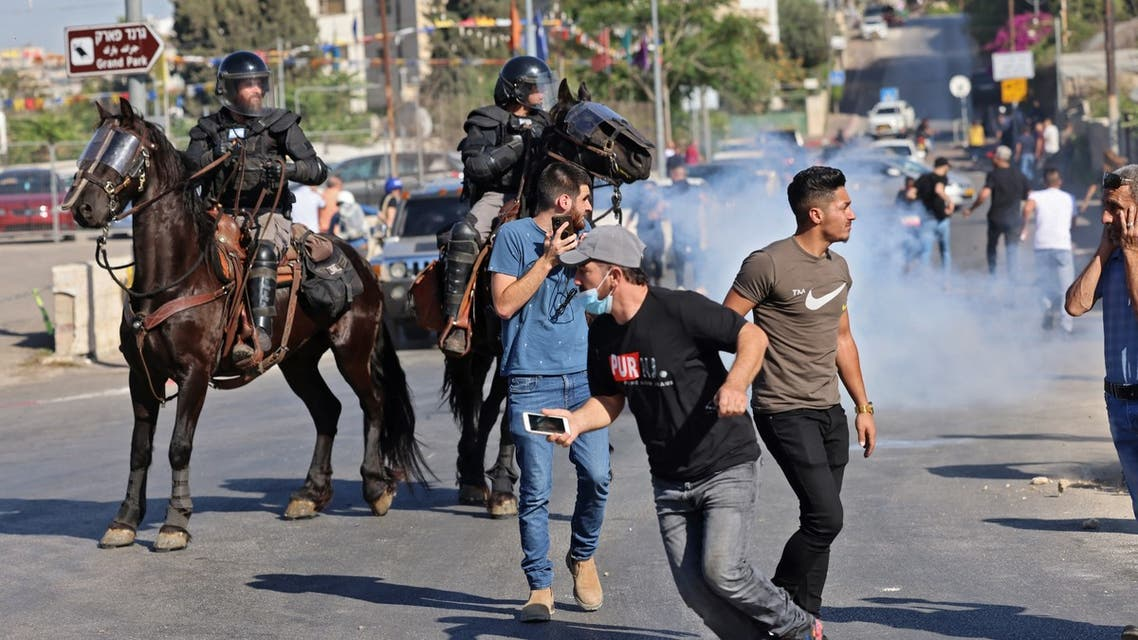 Israeli security forces on horseback disperse Palestinian demonstrators during protests against Israel's occupation and its air campaign on the Gaza strip, at the flashpoint Sheikh Jarrah neighbourhood in east Jerusalem, on May 18, 2021. The UN Security Council was to hold an emergency meeting amid a diplomatic push to end the devastating conflict between Israel and Gaza's armed groups that has killed more than 220 people, most of them Palestinians.