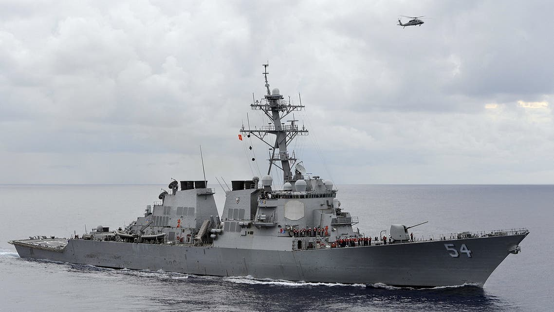 The U.S. Navy guided-missile destroyer USS Curtis Wilbur patrols in the Philippine Sea in this August 15, 2013 file photo. The destroyer sailed within 12 nautical miles of an island claimed by China and two other states in the South China Sea on January 30, 2016 to counter efforts to limit freedom of navigation, the Pentagon said. REUTERS/U.S. Navy/Mass Communication Specialist 3rd Class Declan Barnes/Handout via Reuters/Files ATTENTION EDITORS - THIS PICTURE WAS PROVIDED BY A THIRD PARTY. THIS PICTURE IS DISTRIBUTED EXACTLY AS RECEIVED BY REUTERS, AS A SERVICE TO CLIENTS. FOR EDITORIAL USE ONLY. NOT FOR SALE FOR MARKETING OR ADVERTISING CAMPAIGNS. TPX IMAGES OF THE DAY