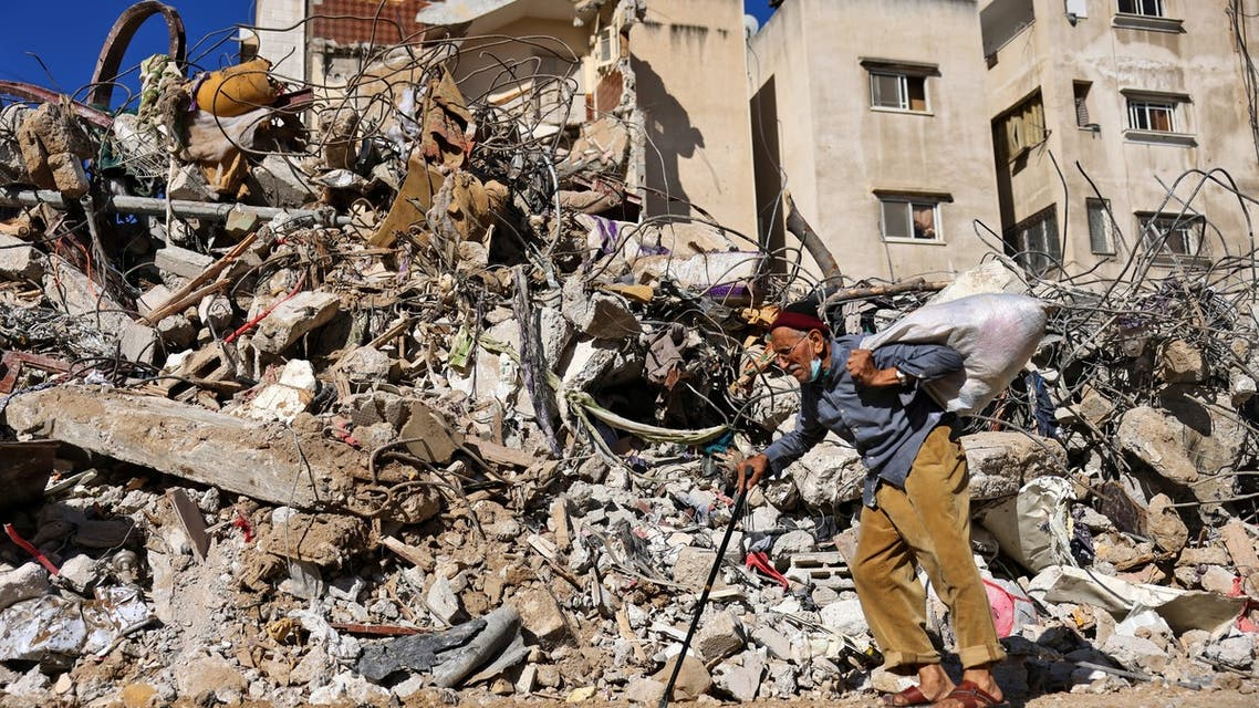 A picture shows destruction at Al-Shuruq building in Gaza City's on May 20, 2021 following Israeli air strikes. Israel and the Palestinians are mired in their worst conflict in years as Israel pounds the Gaza Strip with air strikes and artillery, while Hamas militants fire rockets into the Jewish state. (AFP)