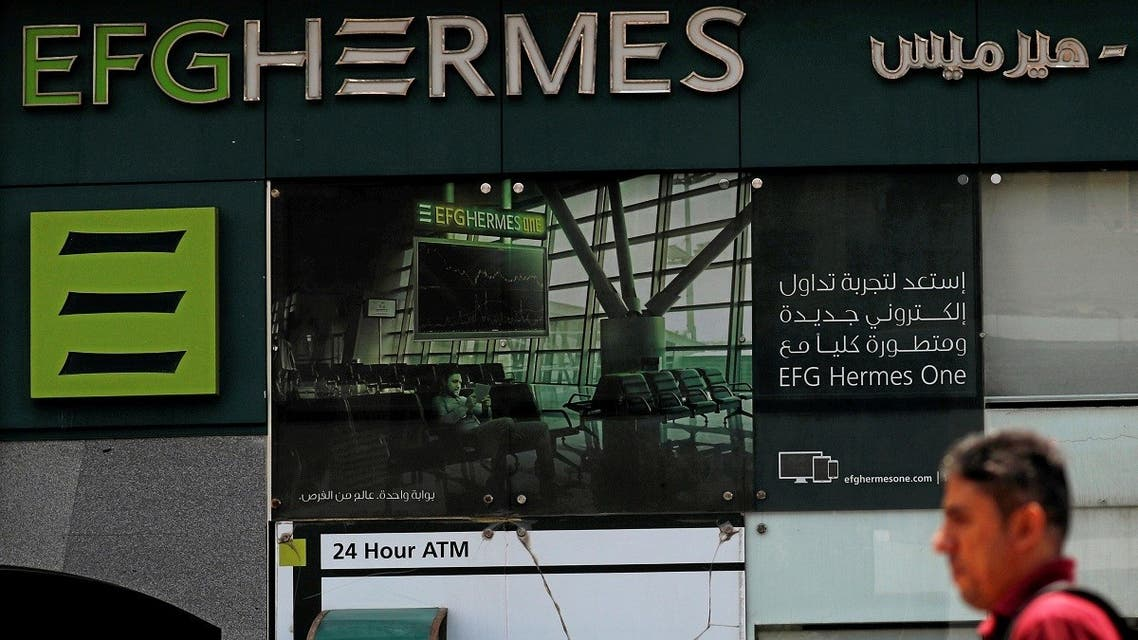 An Egyptian man walks past a branch of the EFG Hermes investment bank in Cairo, Egypt. (File photo: Reuters)