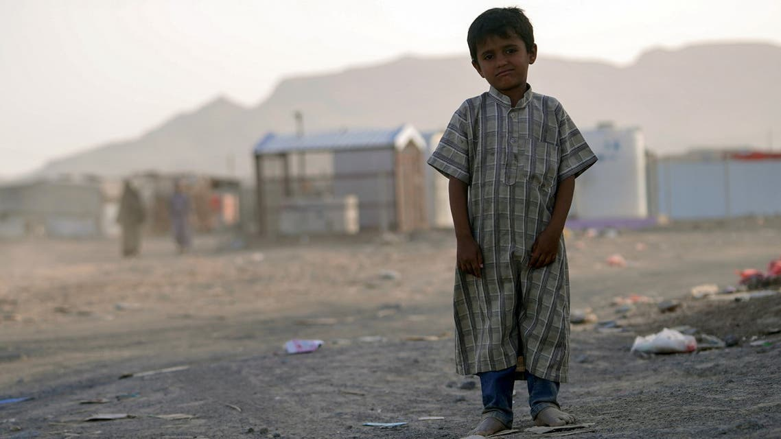 A boy looks on as he stands at a makeshift camp for internally displaced people (IDPs) in the oil-producing Marib province, Yemen May 9, 2021. Picture taken May 9, 2021. REUTERS/Nabeel al-Awzari NO RESALES. NO ARCHIVES