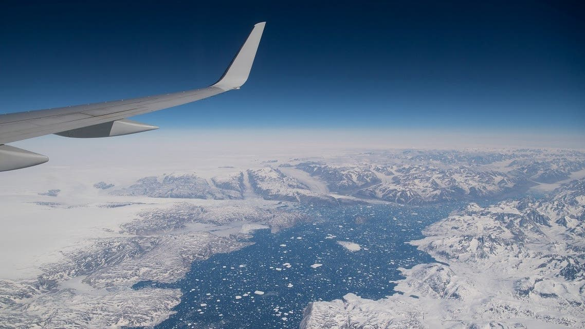 Areas of ice are seen as the airplane carrying US Secretary of State Antony Blinken approaches Kangerlussuaq Airport in Greenland. (Reuters)