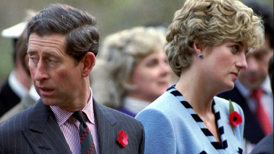 Princess Diana and Prince Charles look in different directions, during a service held to commemorate the 59 British soldiers killed in action during the Korean, on November 3, 1992. (Reuters)