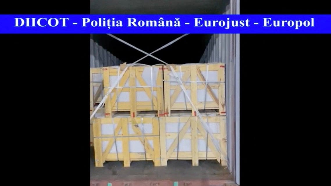 A video grab of footage made available by the Romanian anti-mafia prosecution (DIICOT) taken in Constanta commercial harbour on May 20, 2021 shows a container loaded with stone tiles. The Romanian prosecution announced that it had discovered in the port of Constanta (south-east) nearly a ton and a half of heroin from Iran, one of the largest seizures made in recent years in a country of the 'European Union. Eurojust. (DIICOT / Directorate for the Investigation of Organized Crime (DIICOT)/AFP)
