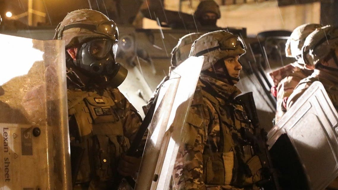Members of the Lebanese army are deployed during a protest against the lockdown and worsening economic conditions, amid the spread of the coronavirus disease in Tripoli, Jan. 29, 2021. (Reuters)