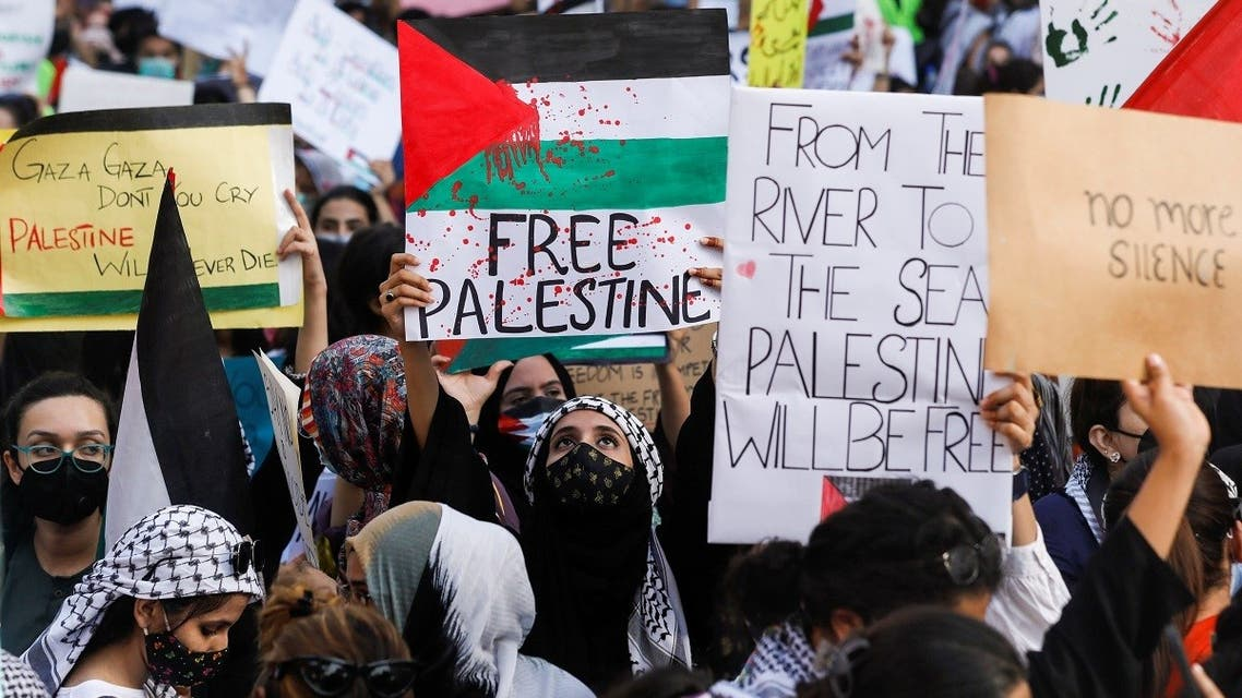 Students carry signs as they chant slogans to express solidarity with Palestinian people, during a protest organized by the Students Action Committee in Karachi, Pakistan May 19, 2021. (Reuters)