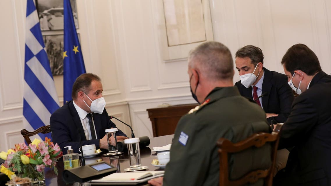 Greek Prime Minister Kyriakos Mitsotakis meets with Executive Director of Frontex Fabrice Leggeri at the Maximos Mansion in Athens, Greece, May 21, 2021. REUTERS/Louiza Vradi
