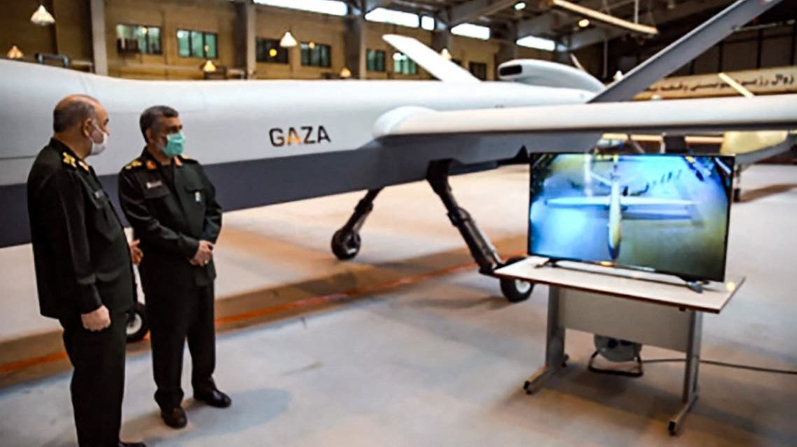 Gen. Hossein Salami (L) and Amir Ali Hajizadeh commander of Aerospace Force of the IRGC, unveiling a new combat drone called 'Gaza' in tribute to Palestinians, in the capital Tehran, on May 21, 2021. (AFP)