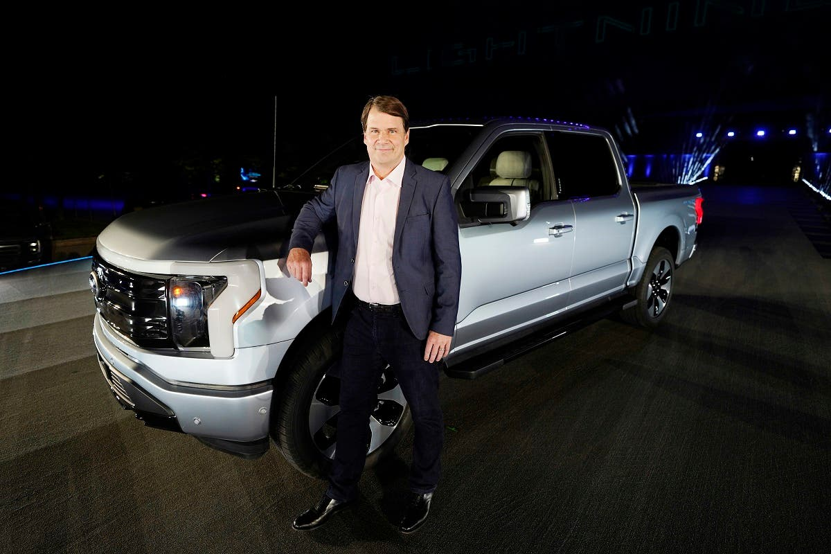 Jim Farley, Ford CEO, stands next to the company's new Ford F-150 Lightning, May 19, 2021. (AP)