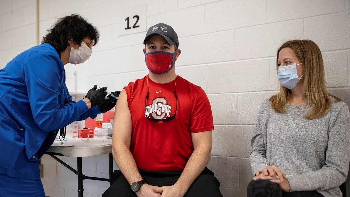 Jake Lawler, 29, receives his coronavirus disease (COVID-19) vaccine as vaccine eligibility expands to anyone over the age of 16 at the Bradfield Community Center through Health Partners of Western Ohio in Lima, Ohio. (Reuters)