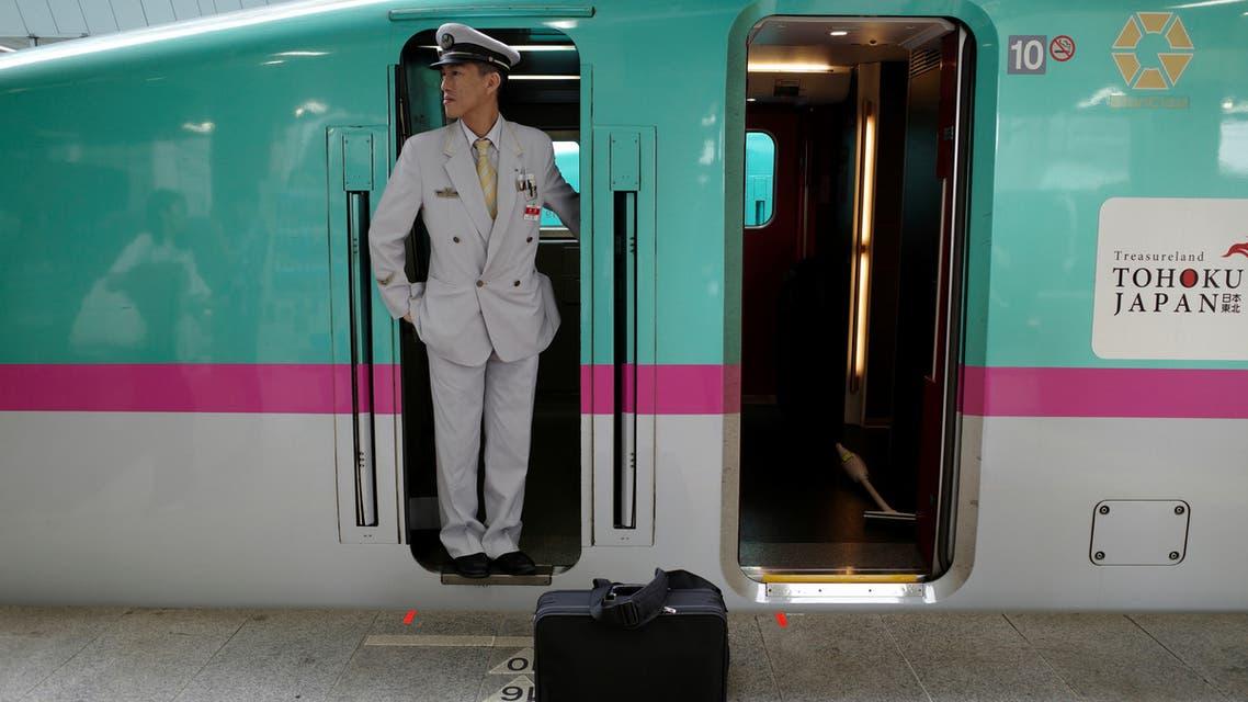 A Shinkansen driver looks on as the Tohoku Line train prepares to depart Tokyo station in Japan September 29, 2019. Picture taken September 29, 2019. REUTERS/Edgar Su
