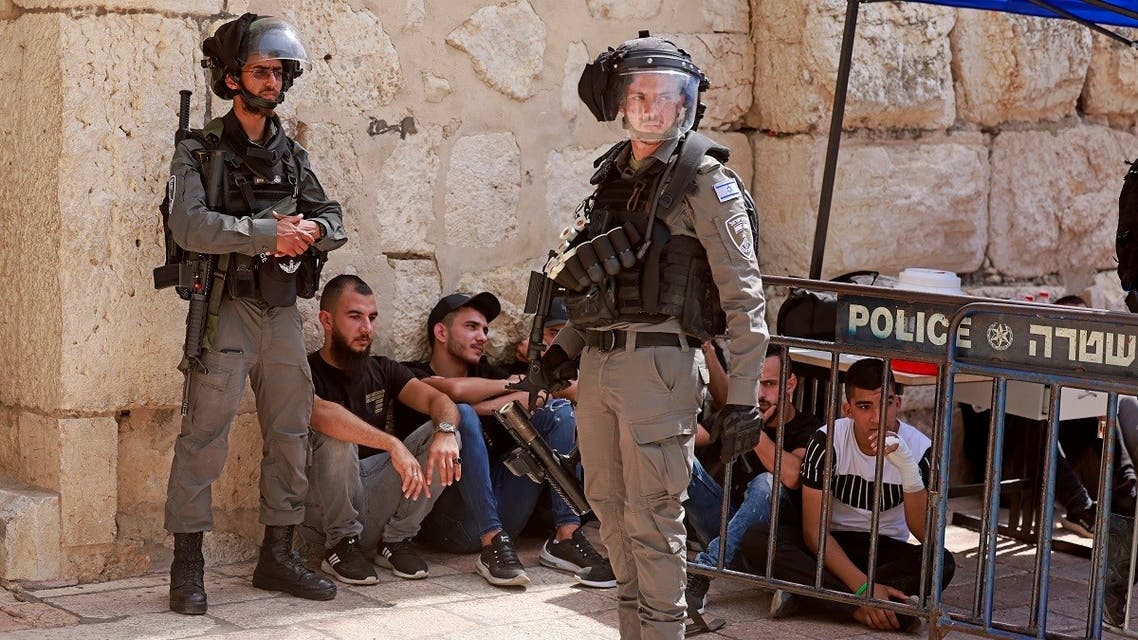 Israeli security forces are pictured at the entrance of Jerusalem's al-Aqsa mosque compound, on May 21, 2021 after fresh clashes between Palestinians and Israeli police broke out. (AFP)