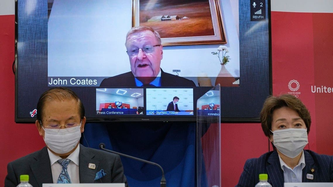 CEO of the Tokyo 2020 Toshiro Muto, left, and President of the Tokyo 2020 Seiko Hashimoto, right, listen to Chairman of the Coordination Commission for the Games of the XXXII Olympiad Tokyo 2020 John Coates, (on screen), delivering a speech during the Tokyo 2020 IOC Coordination Commission press conference on May 21, 2021 in Tokyo. (AP)