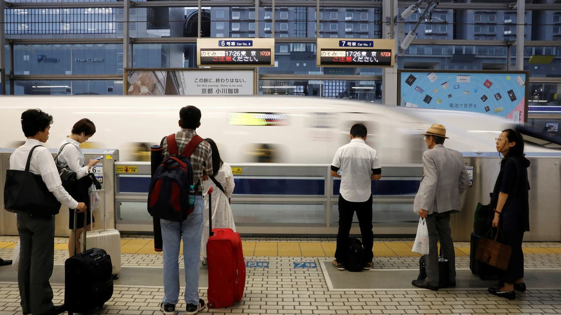 Passengers carrying wheeled luggage wait to board a Shinkansen bullet train at Kyoto Station in Kyoto, Japan, October 1, 2019. Picture taken October 1, 2019. REUTERS/Issei Kato