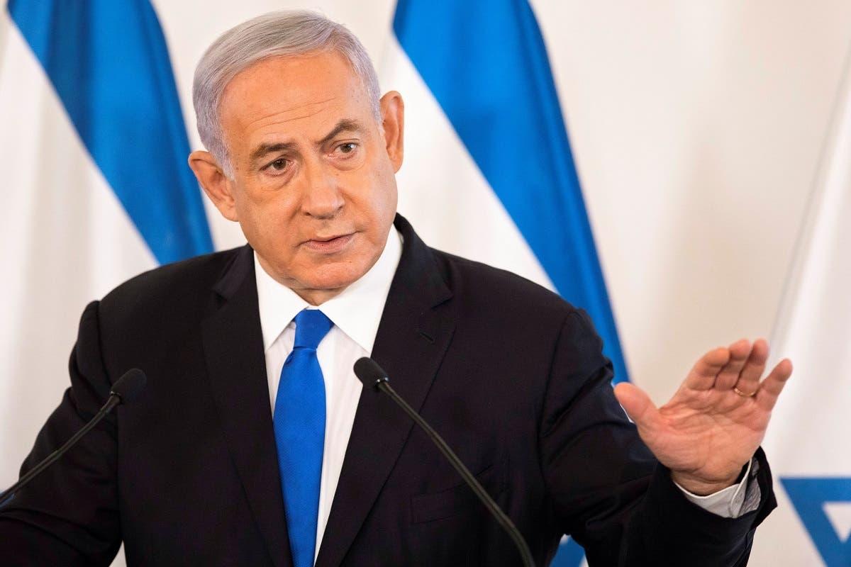 Israeli Prime Minister Benjamin Netanyahu gestures as he speaks during a briefing to ambassadors to Israel at a military base in Tel Aviv, Israel, on May 19, 2021. (Reuters)